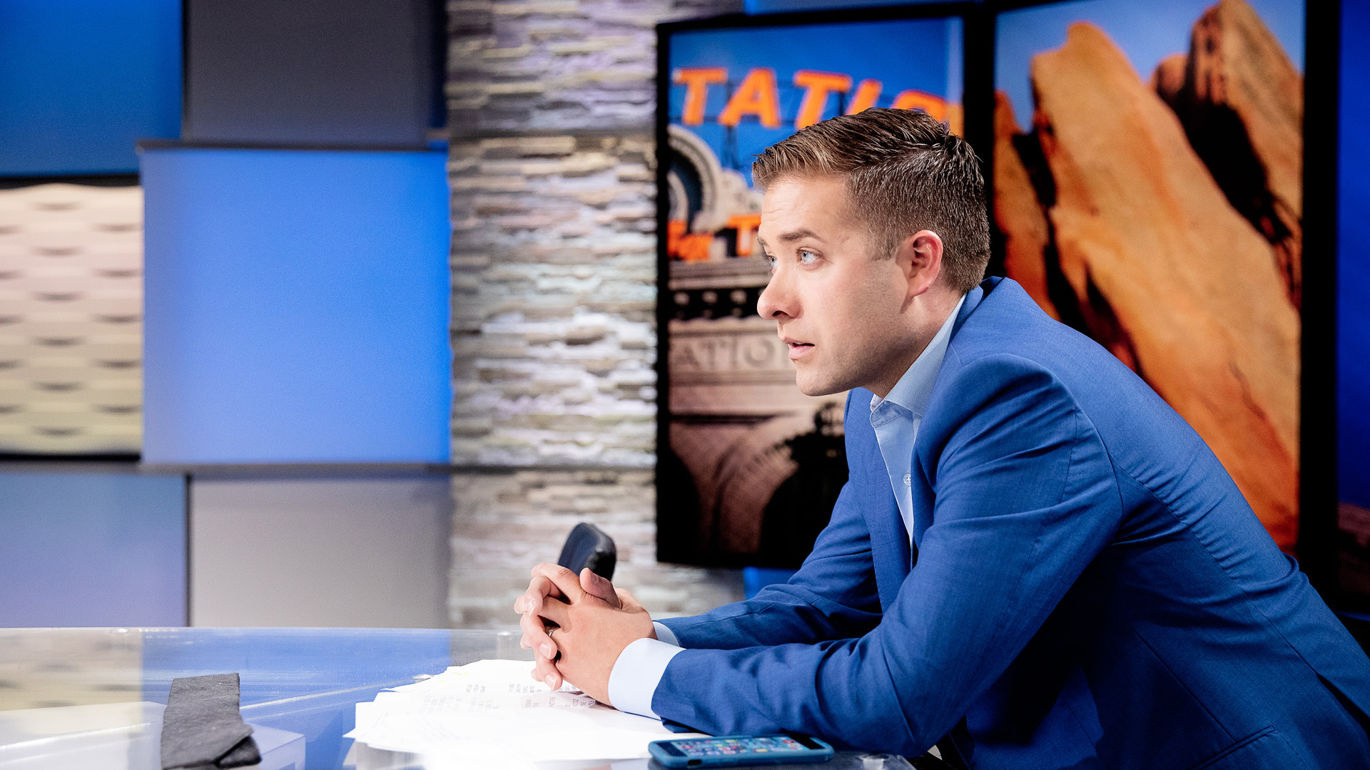 man sitting at anchor desk