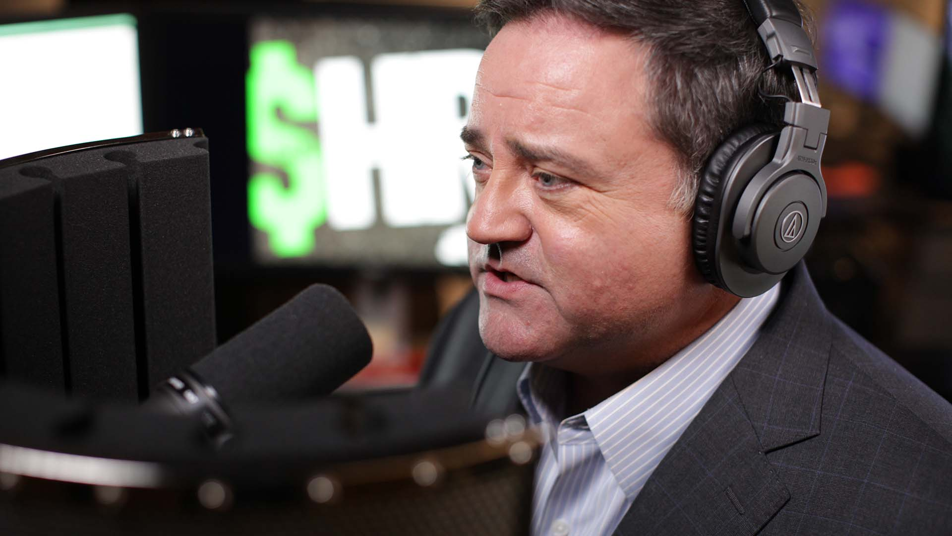 radio host speaking into a microphone
