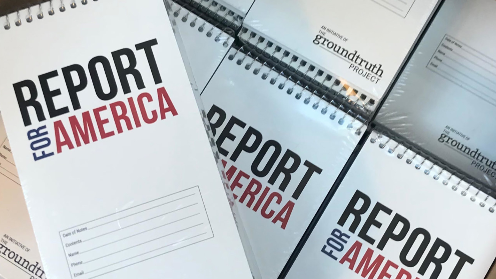 notebooks that say Report for America