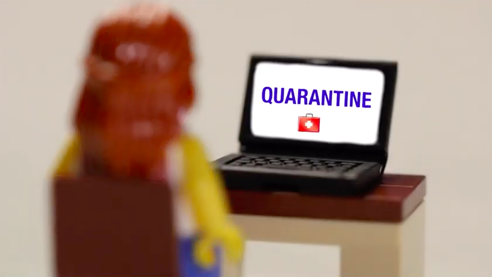 lego person looking at TV during quarantine