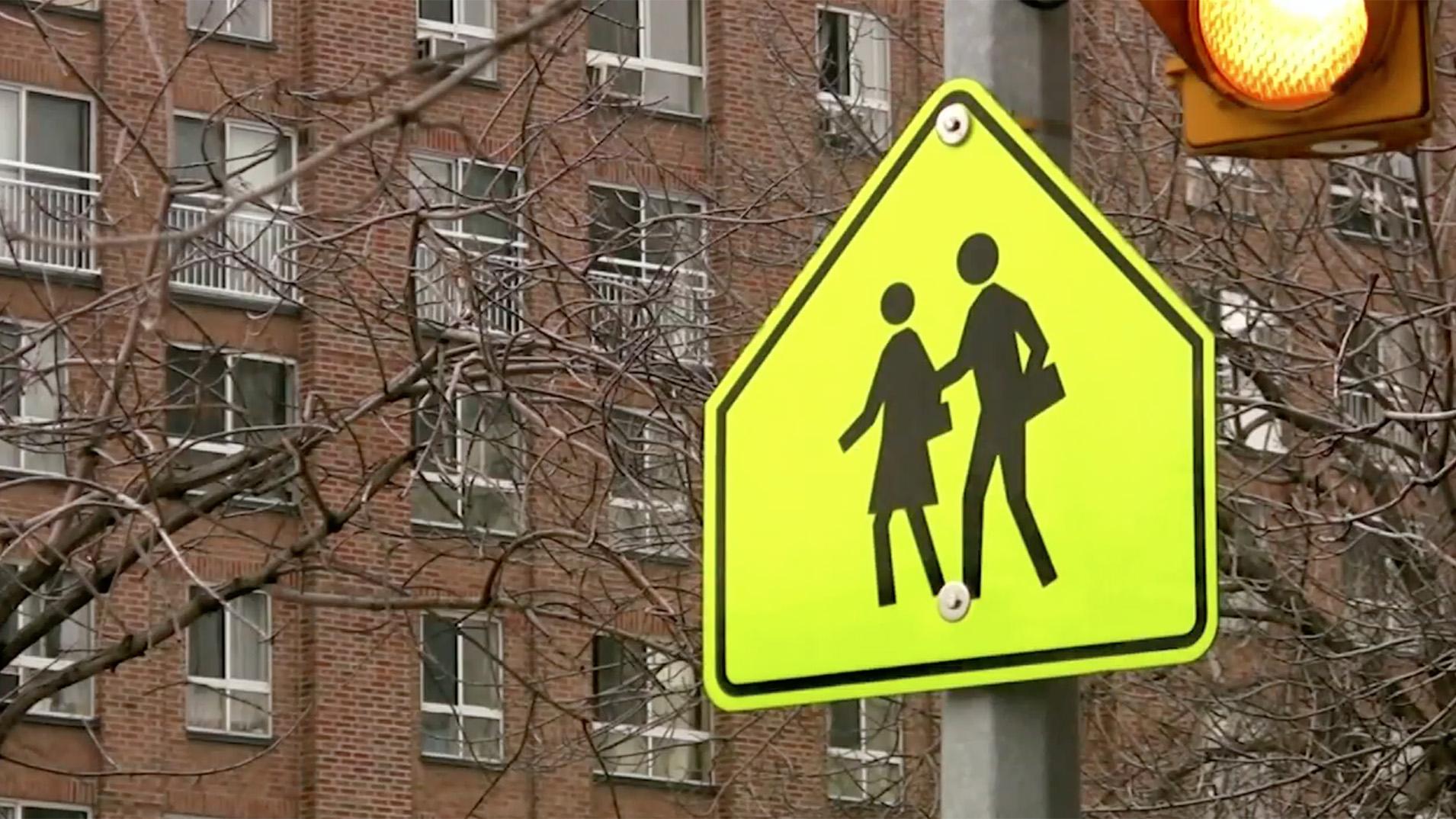 street sign with school crosswalk