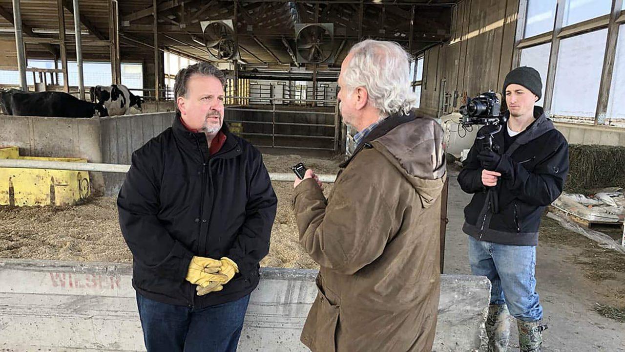 Rick Barrett of the Milwaukee Journal Sentinel interviews a dairy expert for Milwaukee PBS. Scottie Lee Meyers/Milwaukee PBS
