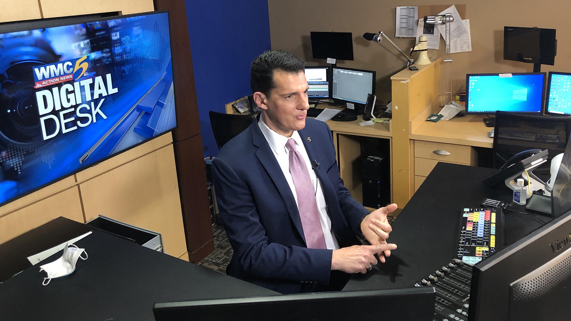 WMC 5 anchor sitting at the digital desk