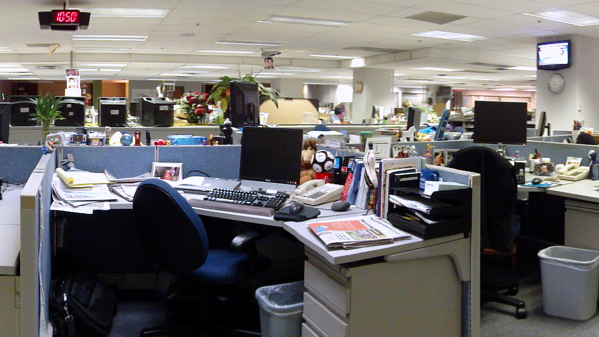newsroom with cluttered desks but no people